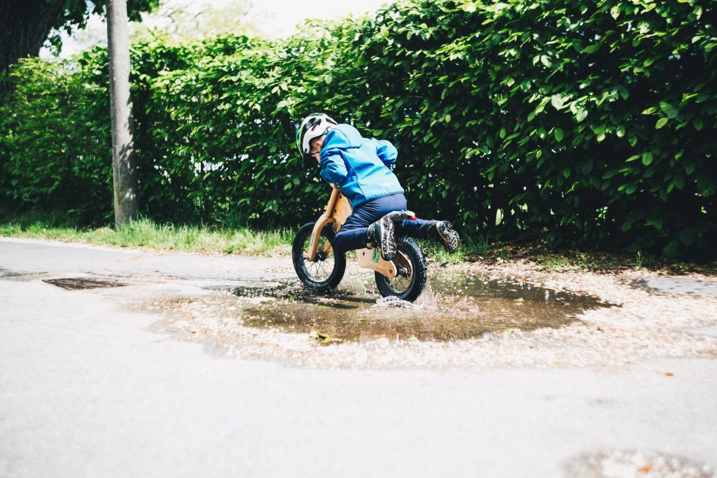 Toddlers Balance Bike in Puddle